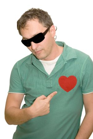 Young man wearing black glasses with his finger pointing at the heart on his chest (isolated on white) photo