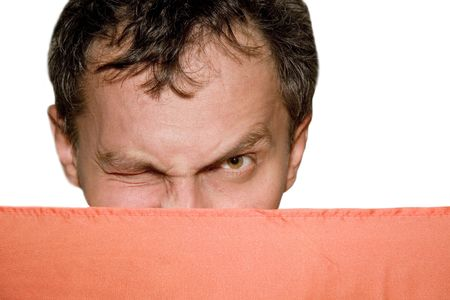 Closeup of a winking man peeping out from behind a screen (isolated on white) photo