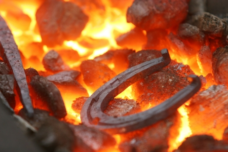 Closeup of a horseshoe in a forge photo