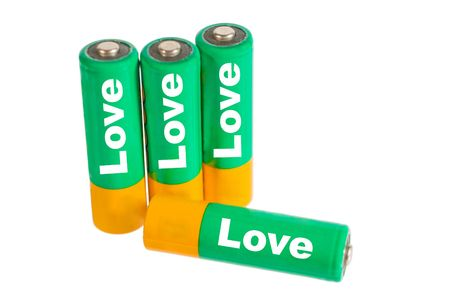 Rechargeable nickel-metal hydride batteries isolated on white (with words Love written on them) photo
