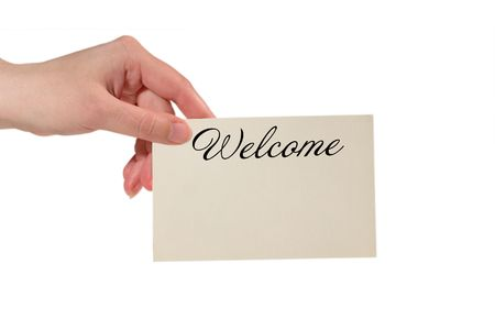 Hand holding a paper card with the word Welcome (isolated on white) photo
