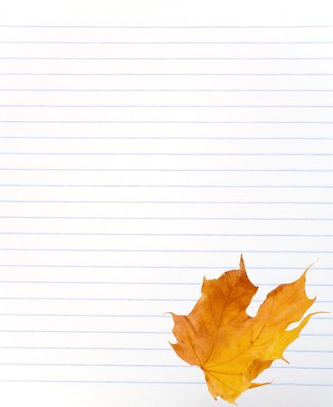 Yellow autumn maple leaf on a blank lined notebook sheet Stock Photo - 5731657