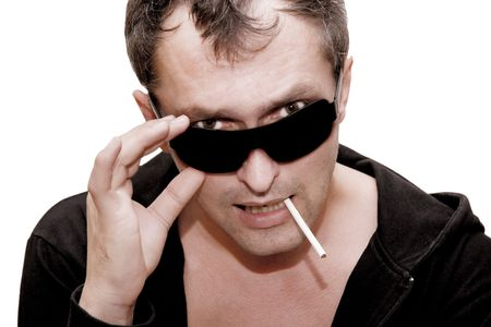 Aggressive-looking man wearing black glasses and smoking a cigarette (a Bad Guy concept) photo