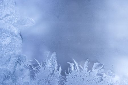 rime: Slightly blurred beautiful frostwork on a window glass (with empty space for your text or image) Stock Photo