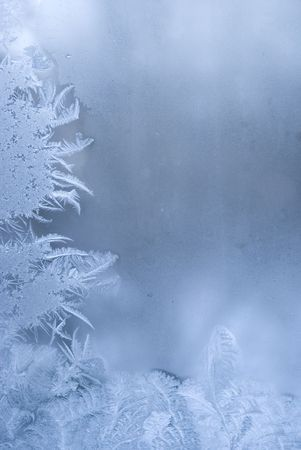 Slightly blurred beautiful frostwork on a window glass (with empty space on the right for your text or image) photo