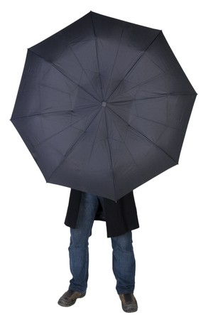 Man hiding behind a black umbrella (isolated on white) photo