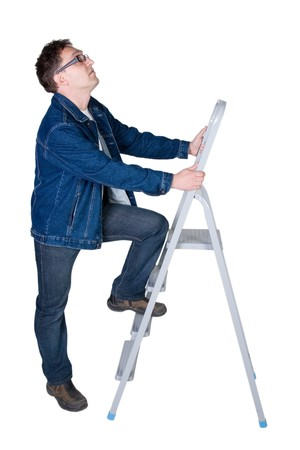 Young man ready to climb a ladder (isolated on white)