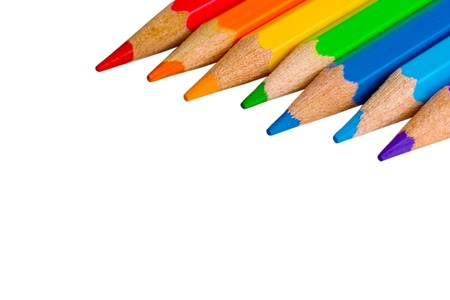 Seven color pencils of rainbow colors (isolated on white, with empty space on the left for your text)