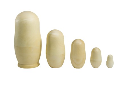 russian nesting dolls: Set of unpainted nested dolls (isolated on white) Stock Photo