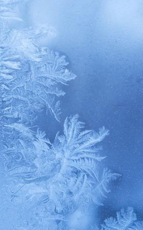 Fairy-like sparkling winter background (slightly blurred frostwork on a window glass) Stock Photo
