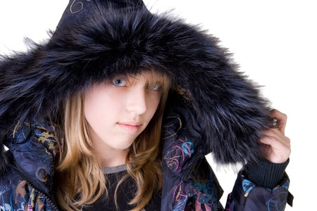 Beautiful blonde girl wearing a jacket with fur (isolated on white) photo