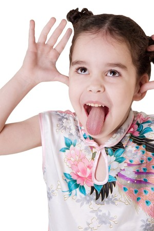 Funny little girl showing her tongue photo