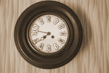 Antique clock on the wall (in sepia)