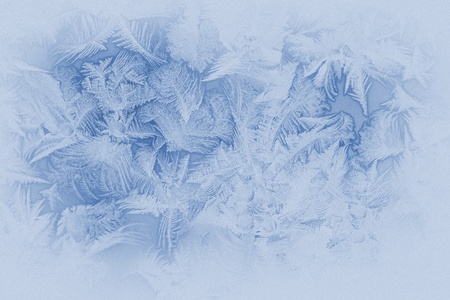 Beautiful frost pattern on a window glass (in subdued colors, retro style) photo
