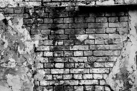 ruined: Old brick wall forming a frame (in black and white) Stock Photo