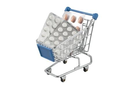 Shopping cart full of pills (isolated on white) photo