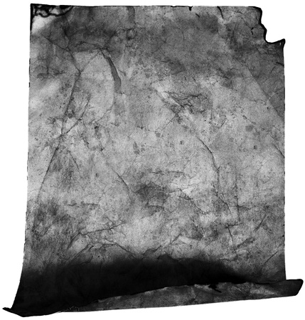 Crumpled old paper in black and white (as a roll isolated on white) photo