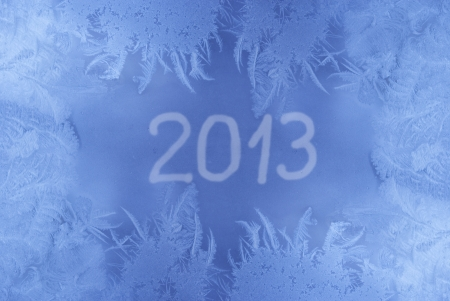 Beautiful New Year background  frozen window with 2013 written on it  photo