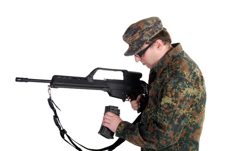 reloading: Soldier reloading a gun isolated on white Stock Photo