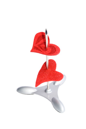 Two red hearts on a paper spike isolated on white Stock Photo