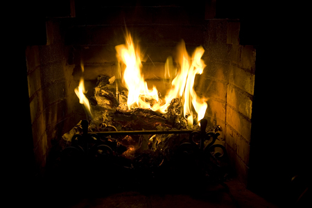 hearth and home: Fireplace with a burning fire Stock Photo