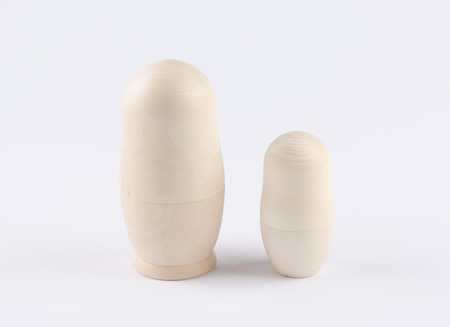 russian nested dolls: Two unpainted nested dolls on a white background