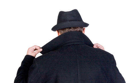 special service agent: Mysterious man hiding his face behind a raised collar Stock Photo