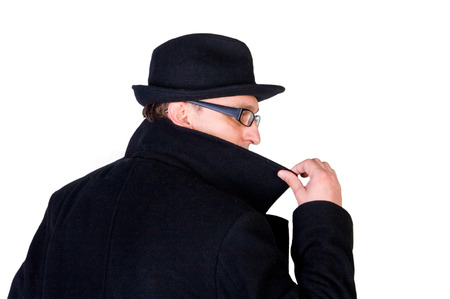 detective agency: Mysterious man hiding his face behind a raised collar Stock Photo
