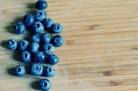 worn: Blueberries against a worn wooden background