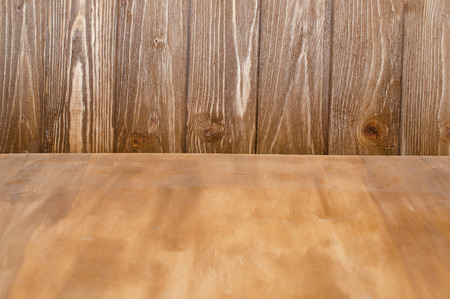 Worn wooden texture as a forefront and wooden boards as a background (selective focus on the wooden boards) Stok Fotoğraf