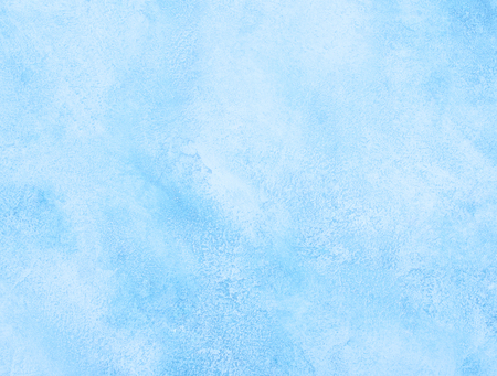 Light blue worn marble or cracked concrete background (as an abstract background or marble or concrete texture)