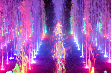 Beautiful multicolored dancing fountains at night (as a colorful abstract background), selective soft focus 版權商用圖片