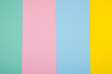 Sheets of paper of different colors as a bright multicolored paper background