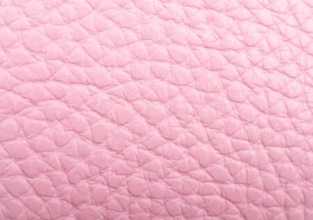 Worn pastel pink leather as a leather texture or an abstract pink background