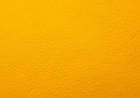 Bright yellow leather as a leather texture or an abstract yellow background