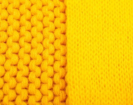 Macro shot of two different bright yellow knitted wool textures Standard-Bild