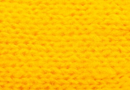 Extreme macro shot of fibers of bright yellow knitted wool (as an abstract yellow background) Standard-Bild - 136412258