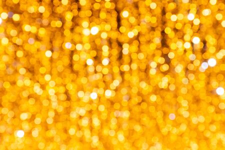 Bright golden soft focus background (as a beautiful festive background)