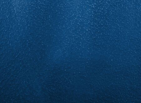 Rough plaster or painted background of classic blue color (concept of Classic Blue as the Color of the Year 2020)
