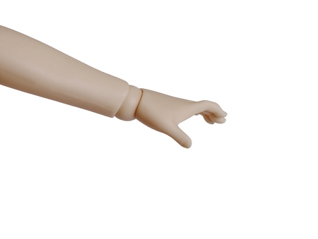 Plastic dummy hand taking some invisible thing. Isolated on white background.