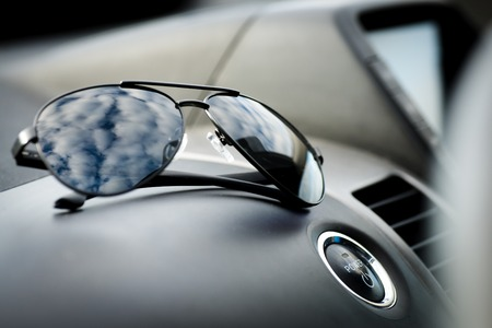 keyless: Sunglasses near the engine start button hybrid car