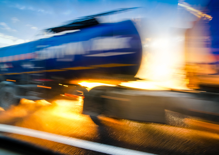 Truck Car in motion blur. Scatter drops through the sunset. Abstract background Stock Photo