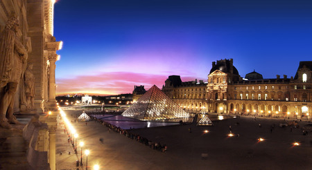 louvre pyramid: PARIS, FRANCE - MAY 15, 2011: The pyramid of the Louvre in Paris in the middle of the Napoleon court where the lobby is located. Tourists Hundreds line up in a purple blue sky at sunset.