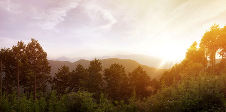 Panorama of a sunset at the top of the Mount Takao at an altitude of 600m located in the city of Hachioji in the prefecture of Tokyo in Japan.