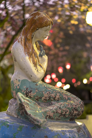 Famous Little Mermaid inspired by Hans Christian Andersen's book under the cherry blossoms of Asukayama Park in the night of Kita district, north of Tokyo.