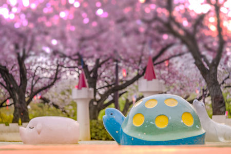 Cute pig, turtle and seal sculptures looking at the cherry blossoms of Asukayama Park in the Kita district, north of Tokyo.
