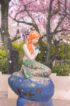 The Little Mermaid from Hans Christian Andersen's book under the cherry blossoms of Asukayama Park in the Kita district, north of Tokyo.