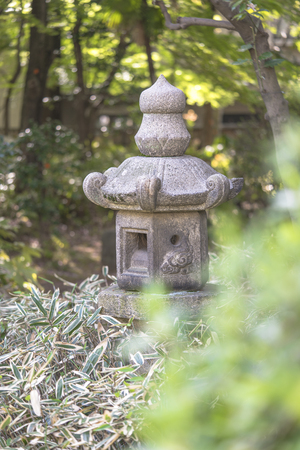 Stone lantern in the garden of Shibusawa Museum of Asukayama park in the Kita district of Tokyo, Japan.It is part of one of the three museums in Asukayama Park and was build in 1925. 스톡 콘텐츠
