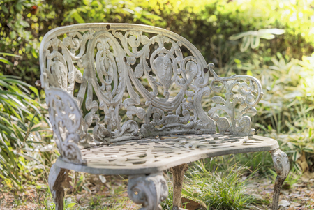White cast iron bench in the garden of Asukayama park in the Kita district of Tokyo, Japan. 스톡 콘텐츠