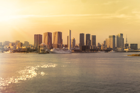 Beautiful sunset view from Rainbow Bridge of Hamamatsucho and Hinode coast in Tokyo Bay with the Symphony Cruise in front and Sky Tree in background.